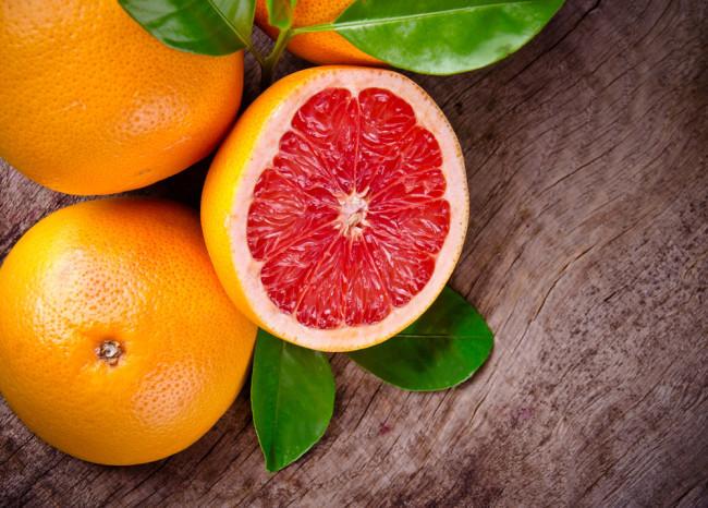 Freshly harvested grapefruit on wooden background